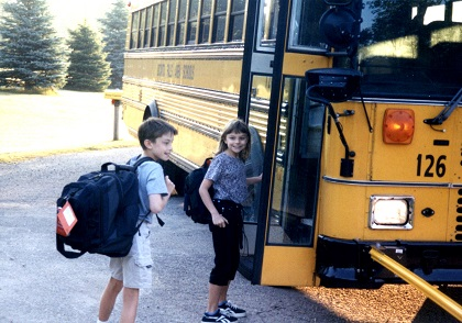 Will and Janet at school bus.